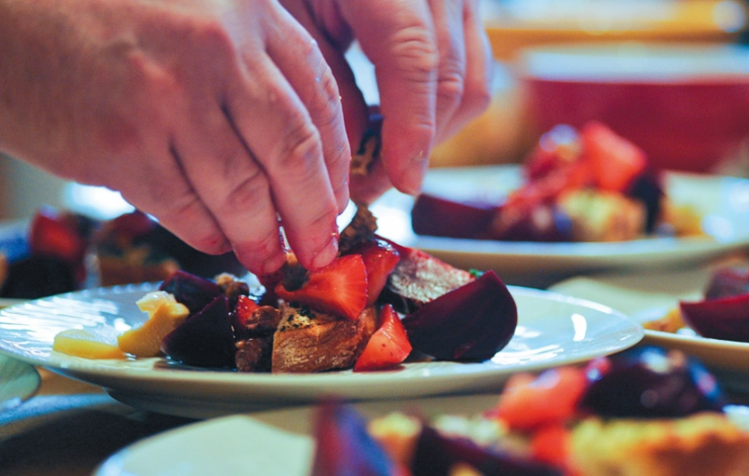 Chef Robert Lhulier plates a beet and strawberry salad.
