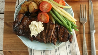 Brown Sugar Whiskey Steak with Roasted Garlic Blue Cheese Butter